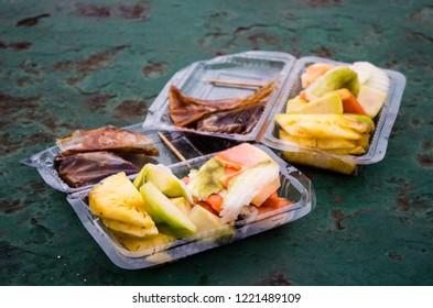 RUJAK - traditional fruit and vegetable salad in Indonesia, two rujaks bought on a ferry.