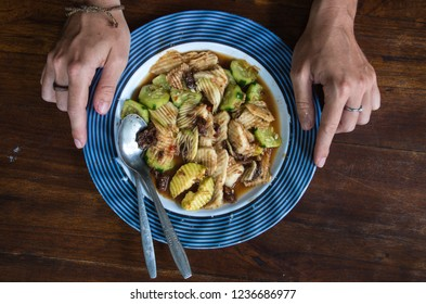 RUJAK - traditional fruit and vegetable salad dish in Indonesia with hands.