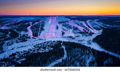 Ruka ski resort slopes. Ruka, Finland, aerial view forest mountains with ski resort - Shutterstock ID 1673560318