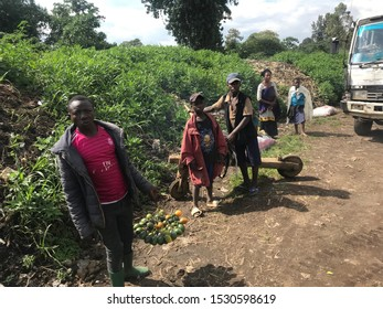 Rukoko, North Kivu / DR Congo - 09 29 2019 : Street scene 7,5 kms outside of Goma, children with traditional wooden transport bike