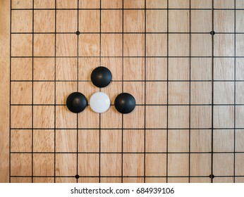 rule of Go game(Weiqi,Baduk),Atari position,Traditional asian strategy board game