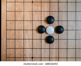 rule of Go game(Weiqi,Baduk),Pon-nu-ki(capture with only 4 stones),Atari position,Traditional asian strategy board game