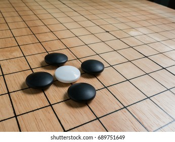 rule of Go game(Weiqi),Pon-nu-ki(capture with only 4 stones),Atari position,Traditional asian strategy board game