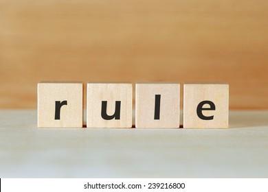 rule word on wood blocks