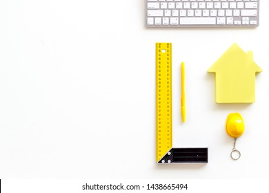 ruler, keyboard, house figure, tools for architect work on white desk background top view copyspace