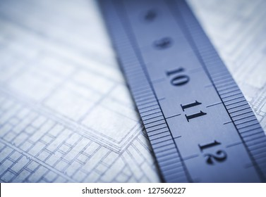 Ruler laying on blueprints