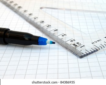 Ruler, pen and notebook on white background