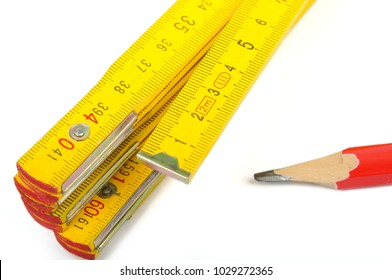 Ruler and red pencil on white background
