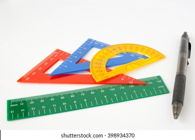 ruler, triangle, protractor and pen