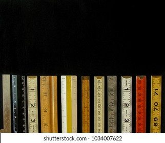 Rulers both metric and inches, scales and measuring tools represent measurement, metrics, precision, accuracy and results with copy space.