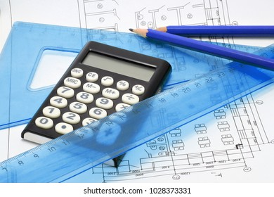 rulers, calculator, pencils on the background of the house plan
