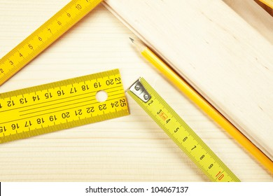 Rulers on a wooden background.
