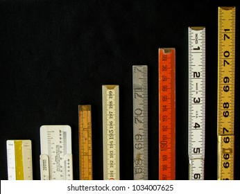Rulers and scales in metric and inches ascend along a chart or graph representing measurement, metrics, precision, increase, growth, accuracy and results with copy space.