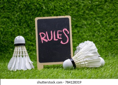 Rules of Badminton with shuttlecocks on green grass