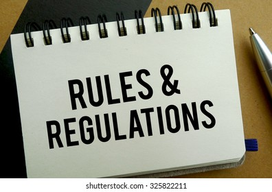 Rules and regulation memo written on a notebook with pen
