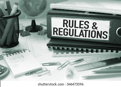 Rules and Regulations / Business concept background in office with papers and files
