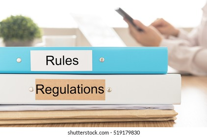 rules and regulations document on desk in meeting room. concept of rules and regulations operational.