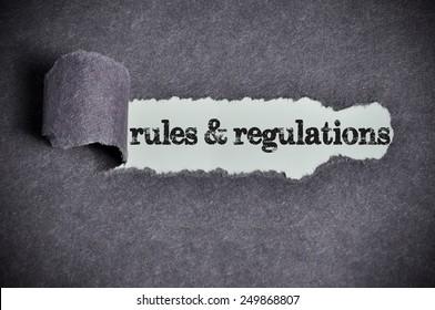 rules & regulations word under torn black sugar paper