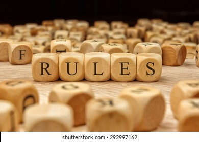 RULES word written on wood block