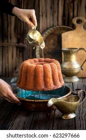 Rum baba - traditional retro classic rum soaked italian dessert from Naples. Savarin. Bundt cake