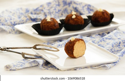 Rum balls of vanilla biscuit with cocao powder, butter cream and nuts. Kartoshka - unbaked biscuit pastry tipically in Russia