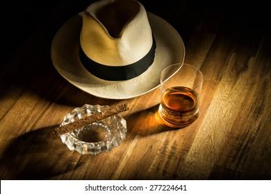 Rum, cigar an a hat