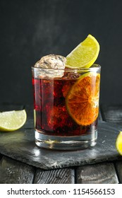 Rum and cola cocktail on dark background