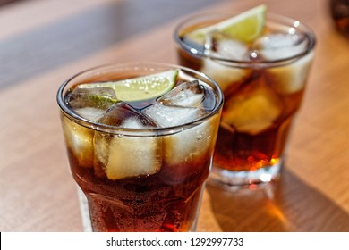 Rum. Cola Cuba Libre with Lime and Ice
