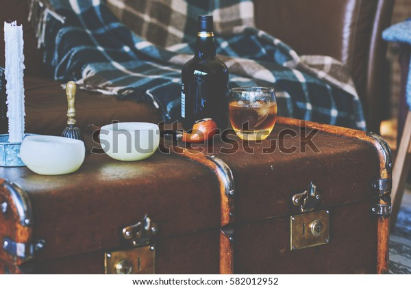 Rum in a glass and smoking pipe  on a dark background.