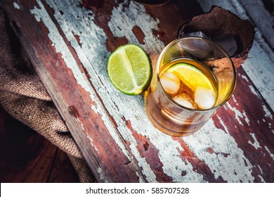 Rum with lime and ice in the hold of a pirate ship