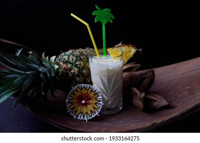 Rum meets pineapple banana coconut. tasty and fruity cocktails served in glasses