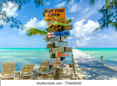 Rum Point, Grand Cayman, Cayman Islands July 2017, signpost by a jetty and the Caribbean sea