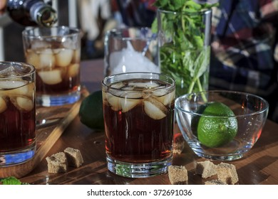 Rum, whiskey, brandy in a glass with ice, lime, a cocktail bar, alcohol. closeup, vintage, alcohol