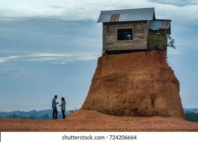 Rumah Jomblo, Gunung Kupang, Banjarbaru, South Kalimantan, Indonesia - September 22, 2017 : Couple having a visit at Rumah Jomblo during sunset