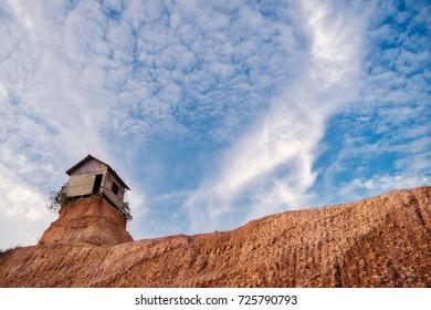 Rumah jomblo, Gunung Kupang, Banjarbaru, South Kalimantan, Indonesia - September 22, 2017 : Small barn left on top of a sand hill in Banjarbaru, South Kalimantan