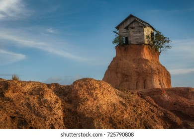 Rumah jomblo, Gunung Kupang, Banjarbaru, South Kalimantan, Indonesia - September 22, 2017 : Small barn left intentionally on top of a sand hill by the developers of the housing complex around it