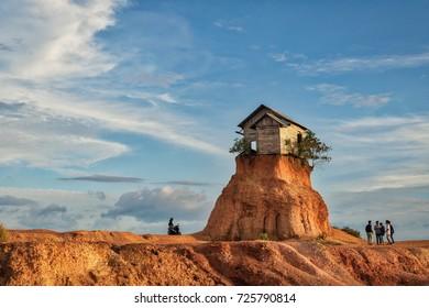 "Rumah jomblo, Gunung Kupang, Banjarbaru, South Kalimantan, Indonesia - September 22, 2017 : Local people/tourists visiting the interesting site of ""Rumah jumble"", the small barn on a sand hill"