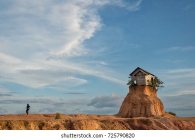Rumah jomblo, Gunung Kupang, Banjarbaru, South Kalimantan, Indonesia - September 22, 2017 : Small barn left on top of a sand hill by the developers of the housing complex around it