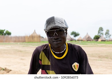 Rumbek, South Sudan,17 July 2017: African man in a cap and sunglasses