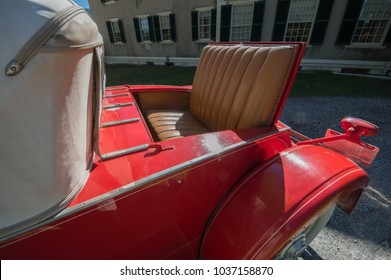 Rumble seat in vintage classic red antique car convertable