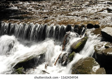 rumbling rock waterfall, rock under the water