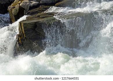 rumbling waters surrounding rock at Great Falls, C&O Canal National Park, Maryland, USA