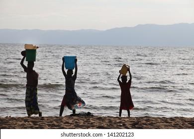 RUMONGE, BURUNDI - CIRCA DECEMBER 2010 - People collecting water from Lake Tanganyika in Reumonge, Burundi circa December 2010.