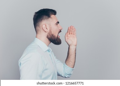 Rumor rumour barbershop hand concept. Half turned close up studio photo portrait of handsome attractive contend candid he him human making announcement isolated grey background copyspace