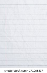 Rumpled sheet of lined paper or notebook paper