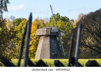 RUMSISKES, LITHUANIA - OCTOBER 16, 2016: Old windmill. Smock mill in green field.