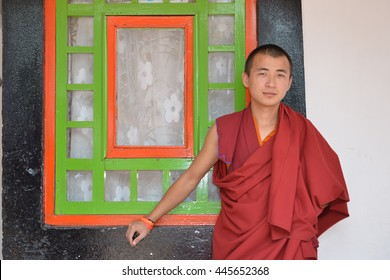 RUMTEK, INDIA - APRIL 13: Monk in the Rumtek Monastery on April 13, 2016 in Rumtek, India. also called the Dharmachakra Centre, is a Tibetan Buddhist monastery located in the Indian state of Sikkim.