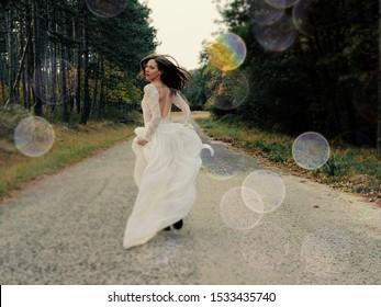 Run away bride running in forest