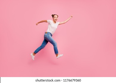 Run, baby, run! Full legs, body, size portrait of young brunette girl running to the store for discounts faster than all isolated on bright pink background