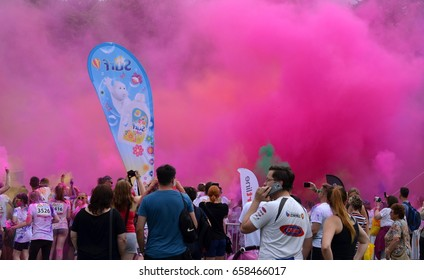 run in colors - colorful fog. Participants of the charitable action Run in colors held in June 3th, 2017, Plzen, Czech Republic